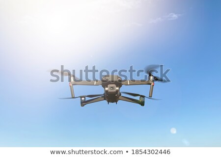 Isolated helicopter against a blue sky Stock photo © njnightsky