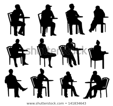 woman silhouette with sitting pose leaning on table Stock photo © Istanbul2009