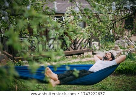 handsome man resting in the hammock stock photo © wavebreak_media