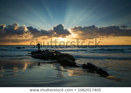Roches surf coucher du soleil Photo stock © LianeM