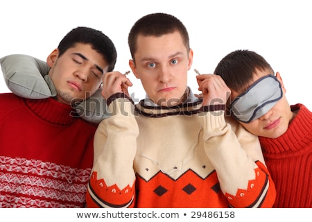 Stock photo: Two sleep, third inserts into plug ears
