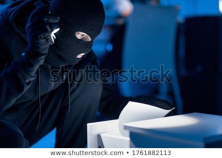 Rapinatore ricerca documenti ufficio cassetto Foto d'archivio © AndreyPopov