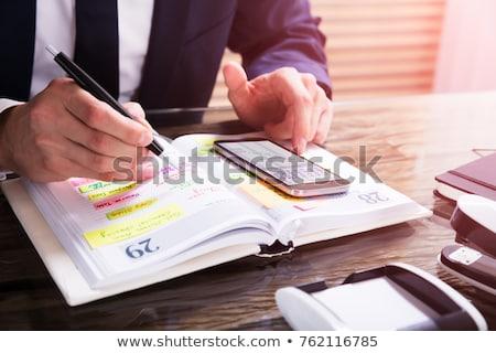 изображение бизнесмен дневнике белый костюм улыбаясь Сток-фото © wavebreak_media