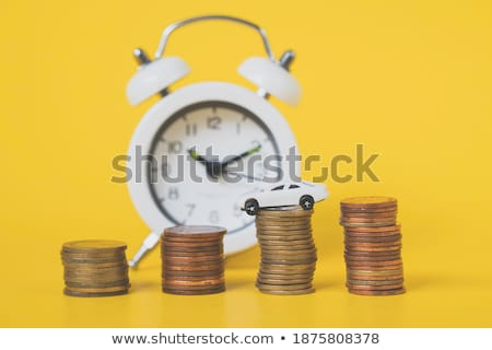 Stack of coins with alarm clock and car Stock photo © cherezoff