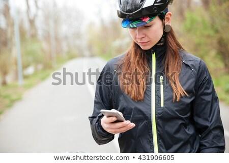 沈痛 女性 自転車 携帯電話 公園 入れ墨 ストックフォト © deandrobot