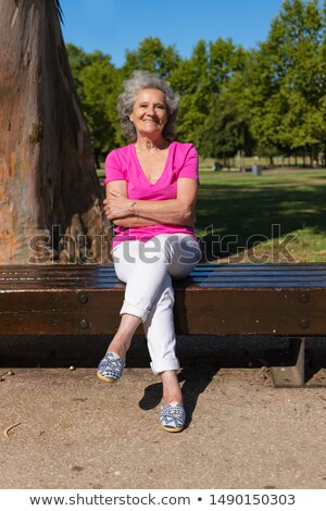 woman in Sitting On Park Bench pose Stock photo © Istanbul2009