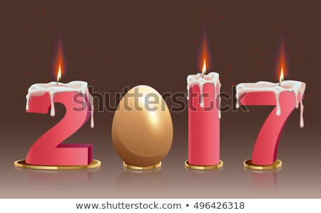 2017 burning candles and golden egg Stock photo © orensila