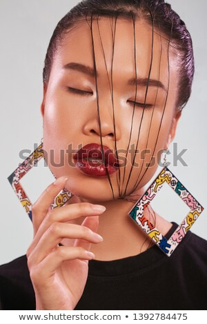 Closeup of a woman touches her chin, abstract background  Stock photo © Nobilior
