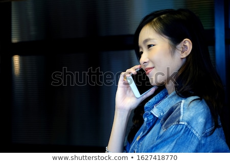 pretty smiling asian woman talking on mobile phone stock photo © deandrobot