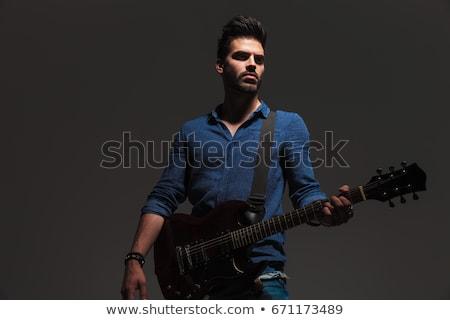 Jeunes dramatique guitariste côté jouer Photo stock © feedough