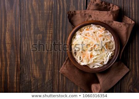 Bowl of sauerkraut on wooden background Stock photo © Digifoodstock