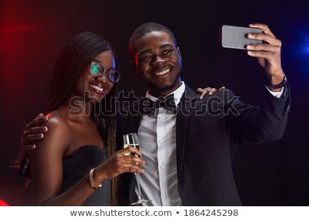 Portrait of elegant people enjoying the nightlife Stock photo © konradbak