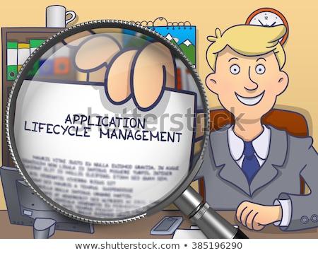 Application Lifecycle Management through Magnifying Glass. Stock photo © tashatuvango