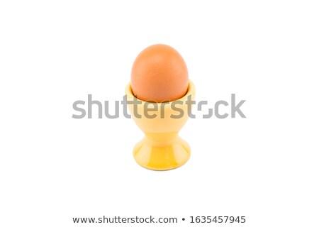 Egg in ceramic cup Stock photo © smuay