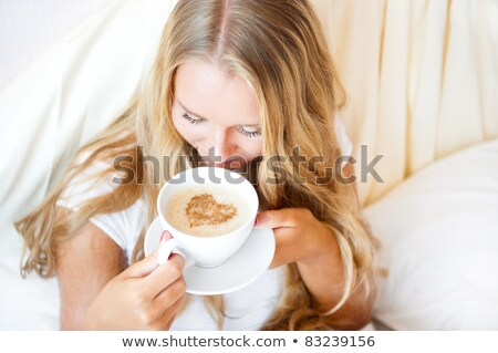 Charming model on hotel bed Stock photo © dash