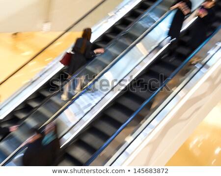Femme marche escalator Voyage couleur valise Photo stock © IS2