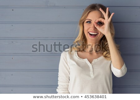Happy blonde business woman showing ok sign Stock photo © deandrobot