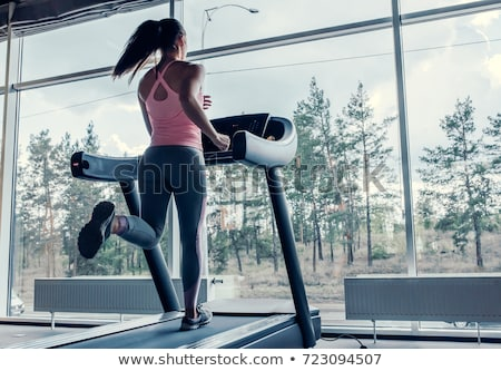 Woman Running On Treadmill At Gym stock photo © monkey_business