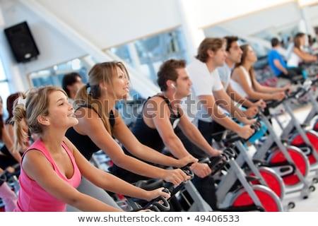 Portrait Sporty Fitt Male Gym Cycling Stock photo © vilevi