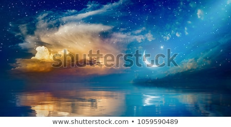 A crescent moon reflection on water Stock photo © bluering