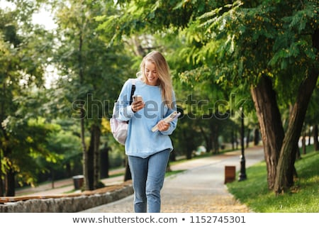 lovely young girl student with backpack carrying books stock photo © deandrobot