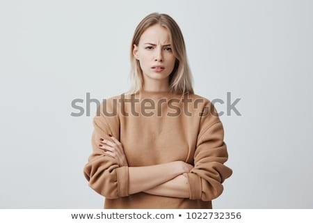 Portrait of an irritated young girl in sweater Stock photo © deandrobot