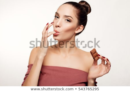 Portrait of a happy young woman holding chocolate bar Stock photo © deandrobot