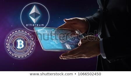 close up of businessman with bitcoin hologram Stock photo © dolgachov