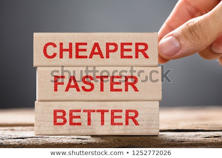 Person Placing Cheaper, Faster And Better Wooden Blocks Stock photo © AndreyPopov
