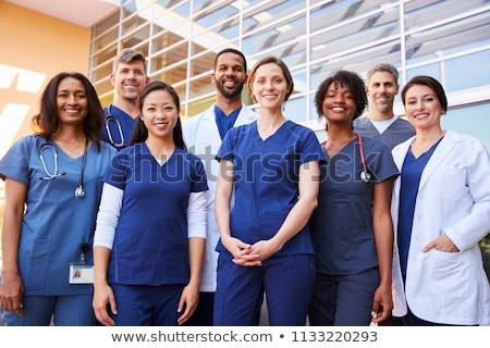jonge · medische · team · vrouw · arts · gelukkig - stockfoto © Minervastock