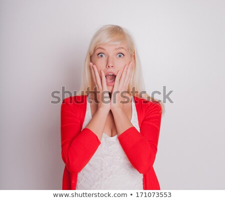 image of surprised blonde woman 20s covering open mouth with han stock photo © deandrobot