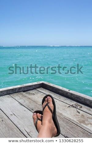 beach turquoise tourist feet relaxed on tropical pier Stock photo © lunamarina