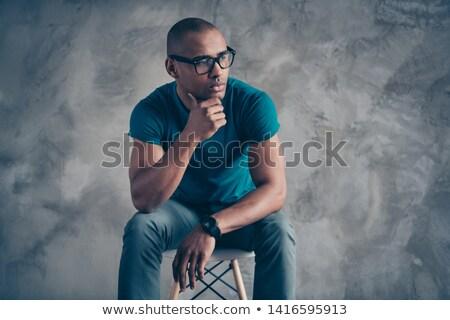 Homem sessão cadeira mão queixo olhando Foto stock © feedough