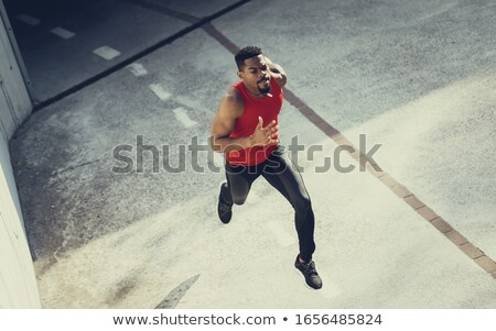 Motivated young sportsman running Stock photo © deandrobot