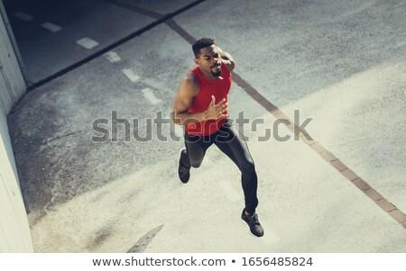 Motivado jóvenes ejecutando estadio deporte Foto stock © deandrobot