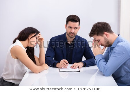 Depressed Couple Sitting In Front Of Judge Stock photo © AndreyPopov