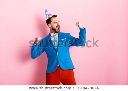 happy birthday greetings man in suit festive cap stock photo © robuart