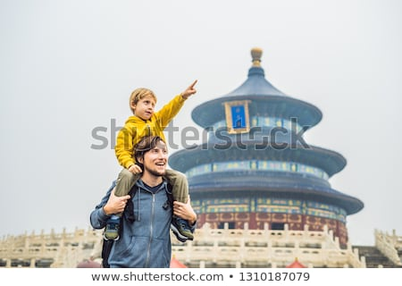 Dad and son travelers in the Temple of Heaven in Beijing. One of the main attractions of Beijing. Tr Stock photo © galitskaya
