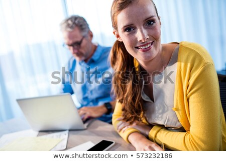 Young elegant businessman concentrating on work Stock photo © pressmaster