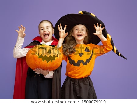 little witch dracula and pumpkin on purple background stock photo © choreograph
