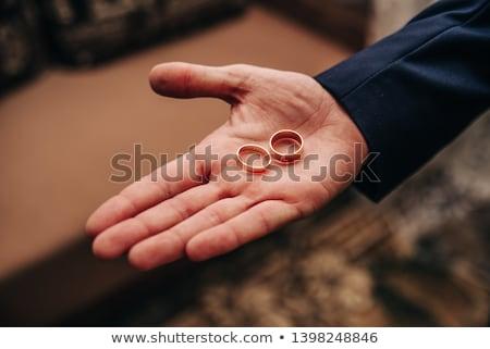 Groom holding wedding rings on the palm Stock photo © Illia