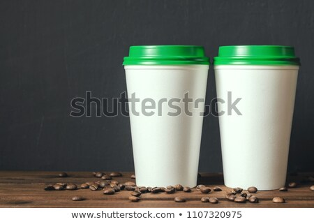 coffee beans in front of plastic cups stock photo © lichtmeister
