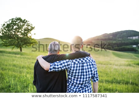 Père en fils forêt prairie famille enfant pomme Photo stock © Lopolo