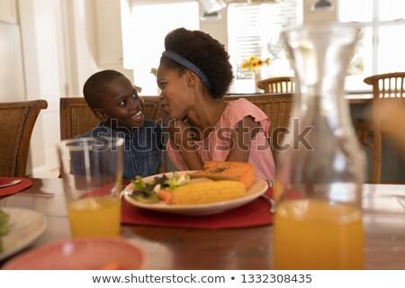 Afro-amerikaanse broers en zussen ander vergadering eettafel vrouw Stockfoto © wavebreak_media