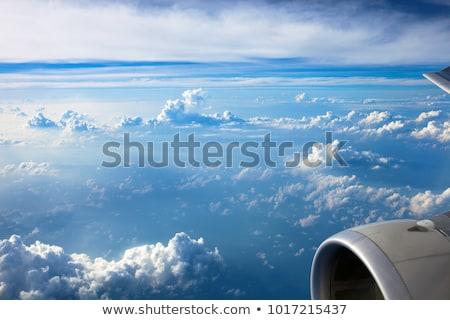 Avion aile ciel bleu nuageux avion bleu Photo stock © artjazz