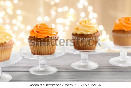 cupcakes with frosting on confectionery stands Stock photo © dolgachov