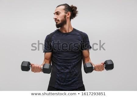 изображение сильный брюнетка спортсмен спортивный костюм Сток-фото © deandrobot