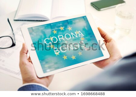 man at a desk and text corona bonds in a tablet Stock photo © nito