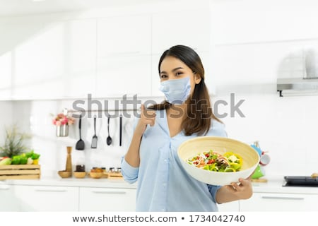 Staying at home woman preparing and cooking vegetarian food Stock photo © Novic