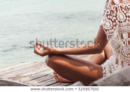 Woman practices yoga asana outdoors Stock photo © dmitry_rukhlenko